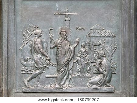 ROME - SEPTEMBER 05: Bronze door with the image of the life of St. Paul: Paul reaches Rome and is welcomed by the faithful, basilica of Saint Paul Outside the Walls, Rome, on September 05, 2016.