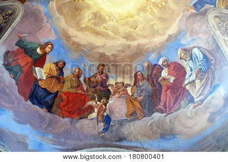 ROME, ITALY - SEPTEMBER 02: The evangelists and prophets detail of frescoes Apotheosis of St James by Silverio Capparoni, ceiling of the Church San Giacomo in Augusta in Rome, on September 02, 2016.