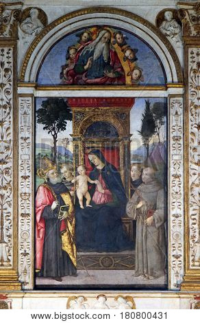 ROME, ITALY - SEPTEMBER 02: The fresco Madonna with the child and saints by Aiuto del Pinturicchio in Basso della Rovere chapel in Church of Santa Maria del Popolo, Rome on September 02, 2016.