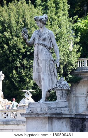 ROME, ITALY - SEPTEMBER 03: Allegorical statue of Summer, Piazza del Popolo in Rome, Italy on September 03, 2016.