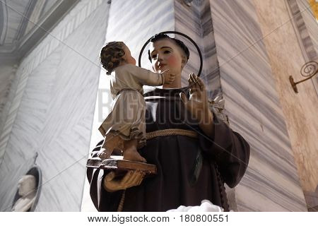 ROME, ITALY - SEPTEMBER 02: Saint Anthony of Padua holding baby Jesus statue in Basilica dei Santi Ambrogio e Carlo al Corso, Rome, Italy on September 02, 2016.