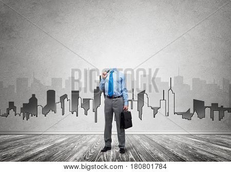 Headless engineer man with case in hand against construction background