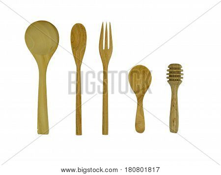 wooden spoon and honey dipper and little spoon kitchenware set on white background