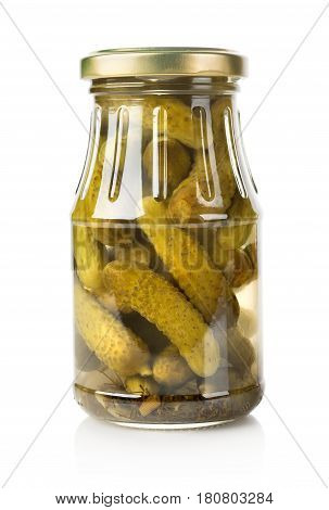 Marinated cucumbers in a glass jar isolated on white