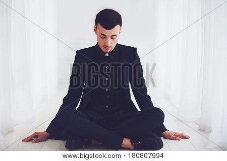 Portrait Of Young Handsome Man Relaxing Indoors