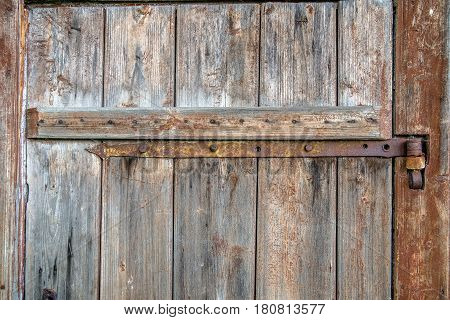 metal part on an old wooden door