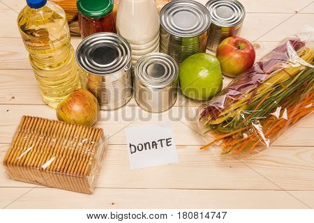 Different Food And Paper Note With Word Donation On Wooden Table, Donation Concept
