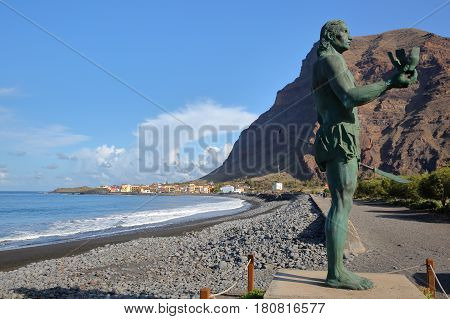 VALLE GRAN REY, LA GOMERA, SPAIN - MARCH 19, 2017: La Playa beach in La Puntilla with the statue of Hautacuperche in the foreground