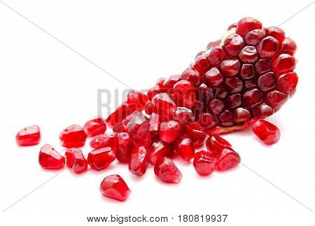 Ripe pomegranate fruit seeds isolated on a white background