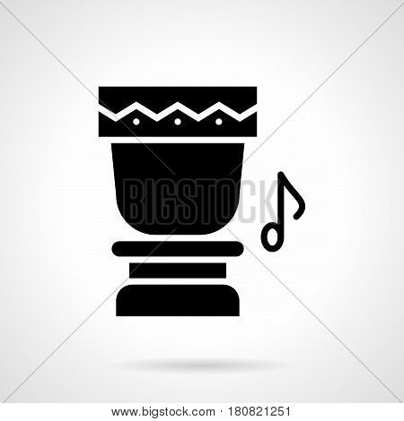 Abstract monochrome silhouette of ethnic drum and note. Percussion musical instruments for tropical party, music festival. Symbolic black glyph style vector icon.