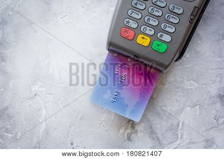 payment terminal and credit card in purchasing concept on stone table background top view mock-up