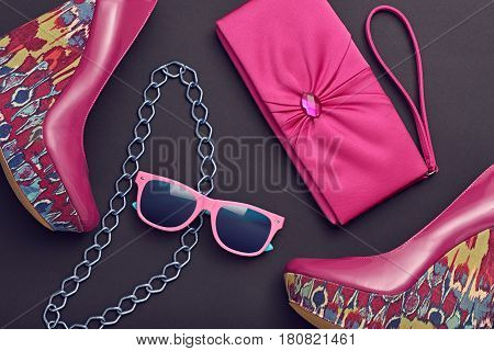 Fashion Design Woman Accessories Set. Trendy fashion Sunglasses, Handbag Clutch. Glamor fashion shoes Pink Stylish Heels. Luxury Shiny Party Night Out lady on Black. Art. Minimal