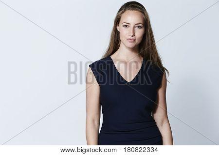 Beautiful girl in dress portrait studio shot
