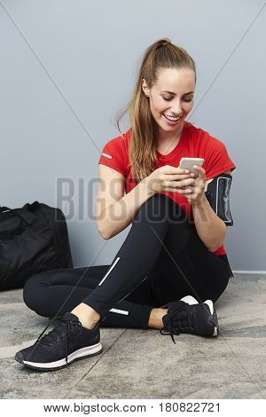 Athlete receiving good news on cell phone