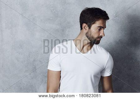 Stubble guy in white t-shirt studio shot