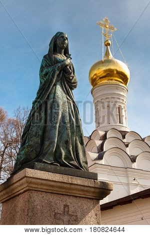 Female Statue On Cemetery. Necropolis Of Donskoy Monastery, Moscow, Russia