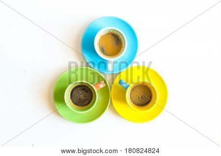 Three colorful coffee cups isolated on white background
