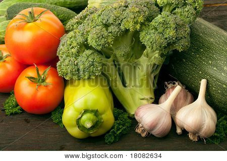 Fresh vegetables: tomatoes, cucumbers, broccoli, zucchini and garlic poster