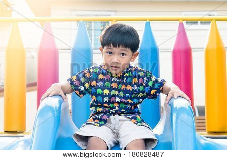 The Asian Boy Having Fun On Playground