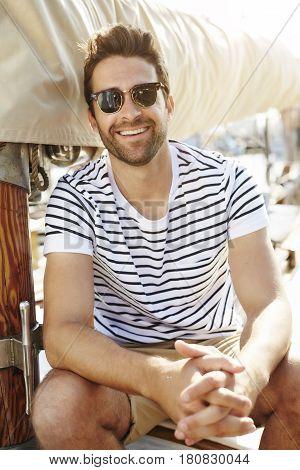 Happy Handsome sailor Man onboard boat smiling