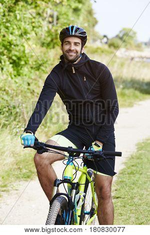 Portrait of Handsome man on bicycle portrait