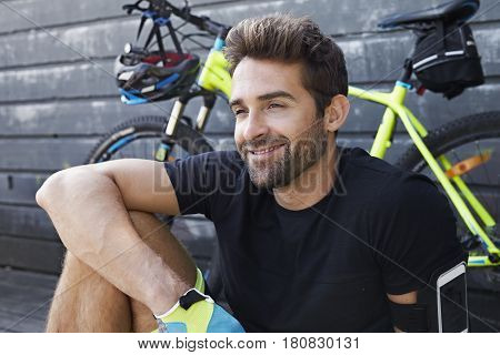 Smiling cycle guy taking a relaxing break