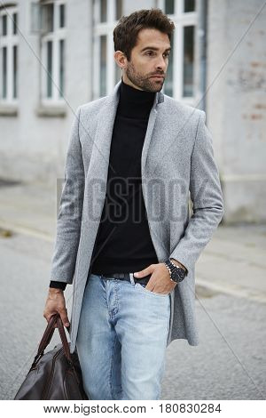 Cool Handsome city guy looking away street fashion