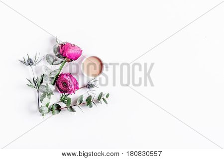 Modern spring design with bright pink flowers and coffee on white desk background top view moke up