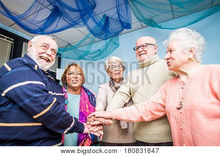 Senior adults in a nursing home for the elderly doing leisure activities