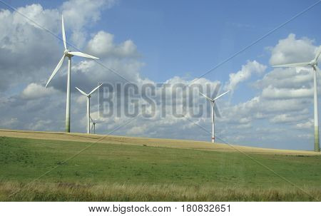 Windmills for electric power production Sudetenland. Windmills. Summer.