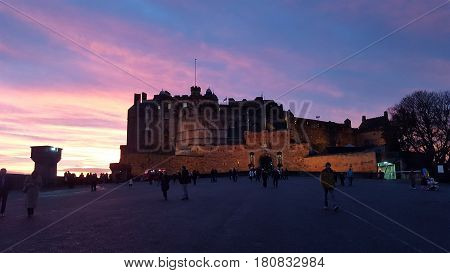 Castle of Edinburgh with the sky at sundset as background