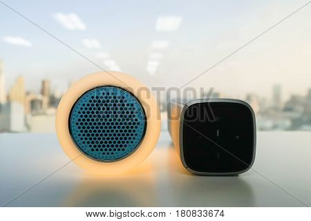 close up glow speaker in orange color and modern wireless speaker for listening to music