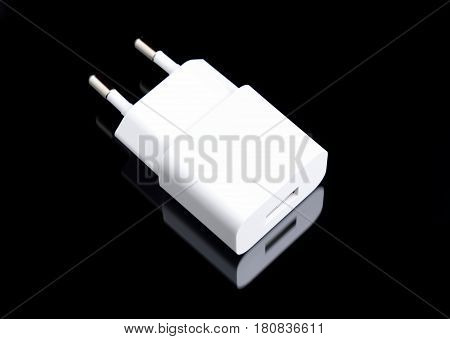white charger adapter on black background minimal picture