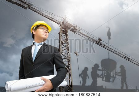 Management consulting holding blueprint in his hand for management business plan.