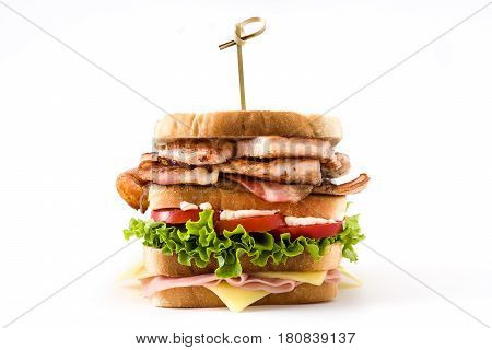 Club sandwich with ham,cheese,lettuce,tomato,chicken and bacon isolated on white background.