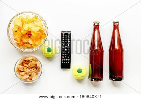 TV remote control, snacks, beer on white desk background top view space for text