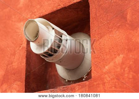 Chimney for smoke outlet on the wall. Forced circulation airtight double boiler. Outdoor flue and air intake.