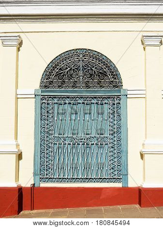 Facade of the colonial house built by Spanish colonizers by one of streets in the most tourist Trinidad city on Cuba