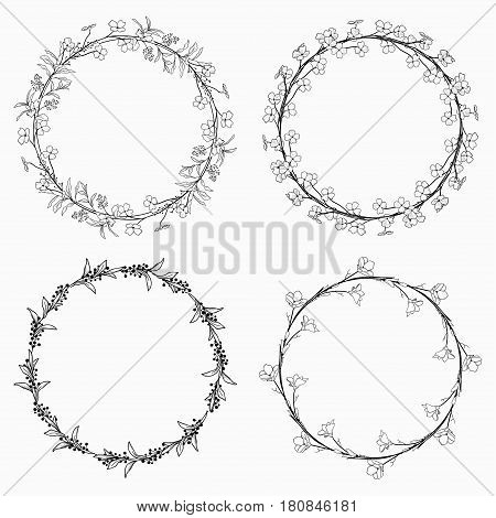 Set of 4 Black Hand Drawn Decorative Outlined Wreaths, Branches, Laurels with Herbs, Plants and Flowers, Florals. Vector Illustration. Frames, Circles