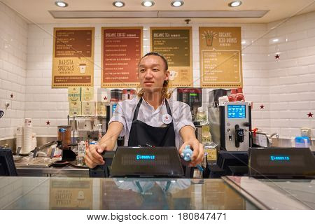HONG KONG - CIRCA NOVEMBER, 2016: indoor portrait of a man at Pret a Manger in Hong Kong. Pret a Manger is a sandwich shop chain based in the United Kingdom.