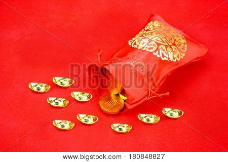 Chinese New Year Decoration: Red Fabric Packet Or Ang Pow With Chinese Style Pattern And Golden Coin