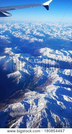 Aerial view on the Swiss alps from plane