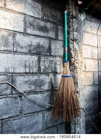 Broomstick Hanging on Wall . . .