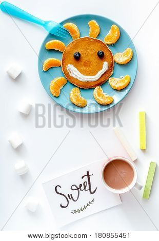 concept kid breakfast with pancake top view on white background.