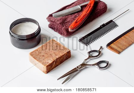 white desktop with tools for shaving beards close up