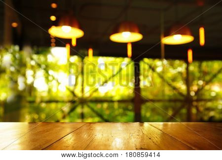 three lamp in pub or bar in the dark green light with wood table background