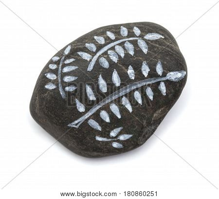 pebble painting - lava pebble with floral design on white background