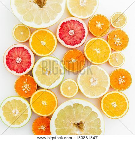 Fresh lemon, orange, mandarin, grapefruit and sweetie on white background. Flat lay, top view.