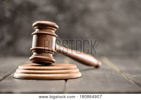 Close-up View Of Brown Mallet Of Judge On Wooden Table On Grey, Law Concept