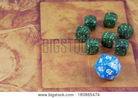 One blue dice with seven green dices on the orange background